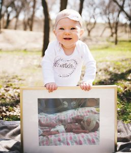 Toddler with photo